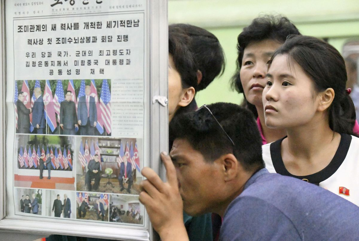 North Koreansexamine local newspapers reporting the summit between the U.S. and North Korea at a subway station in Pyongyangon Wednesday. Kyodo/via REUTERS