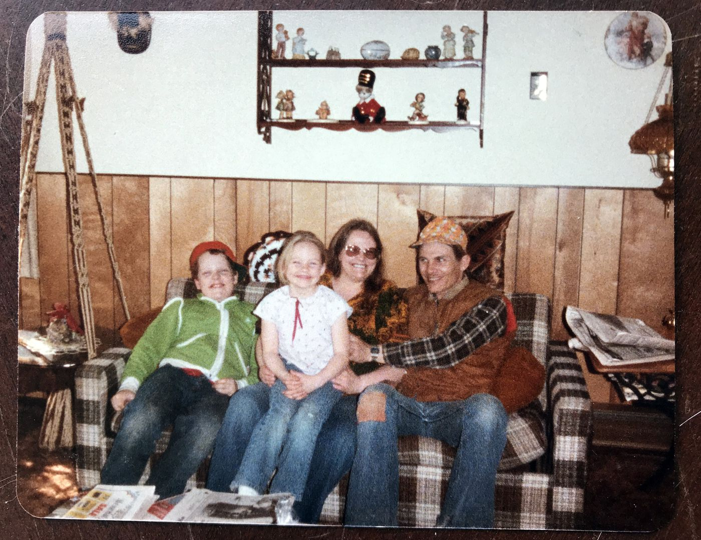 A family photograph of Sherri Stewart with her brother, mother Beth Blake and stepfather Dennis Mouser at her grandparents' homestead in Sterling. (Photo courtesy of Sherri Stewart)