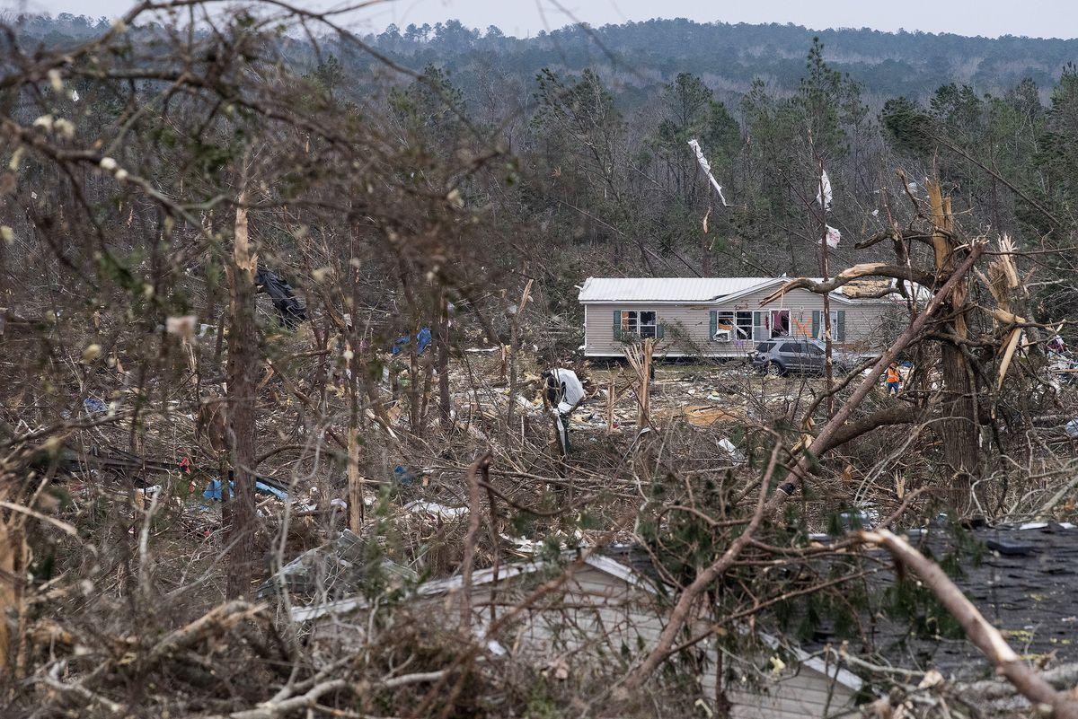 Tornado damage near Beauregard, Ala., on Monday March 4, 2019. Friends in eastern Alabama are helping tornado survivors retrieve the scattered pieces of their lives after devastating winds destroyed their homes and killed at least 23 people. (Mickey Welsh/Montgomery Advertiser via AP)