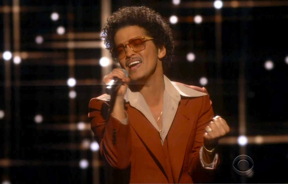 In this video grab provided by CBS and the Recording Academy, Bruno Mars performs 'Leave The Door Open 'at the 63rd annual Grammy Awards at the Los Angeles Convention Center on Sunday, March 14, 2021. (CBS/Recording Academy via AP)