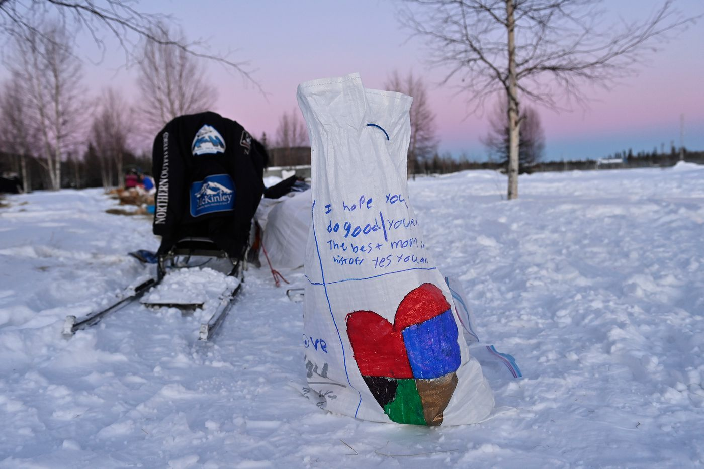 A message left on a drop bag reads 'I hope you do good. You are the best mom in history ' at the first checkpoint of the Summit Quest 300 on February 13, 2021. (Marc Lester / ADN)