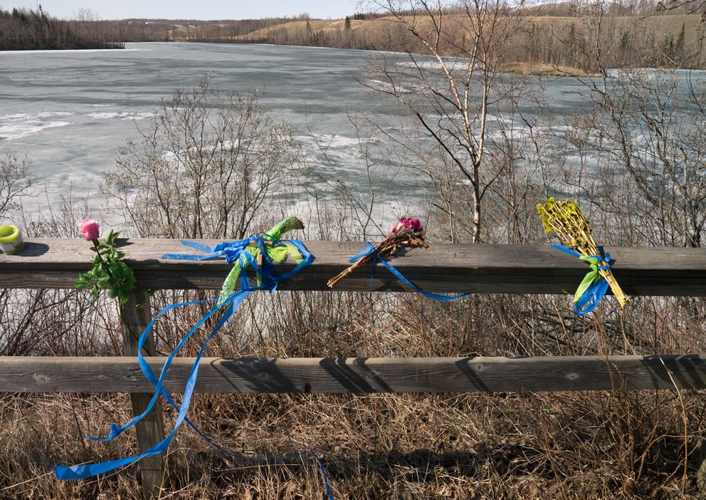 Flowers are left at an overlook of Matanuska Lake on April 26, 2012. FBI divers found the body of Samantha Koenig under the ice there in April 2012. Police say she was abducted from an Anchorage coffee stand in February and killed by Israel Keyes. (Marc Lester / ADN)