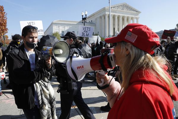 Counterprotesters confront participants in the MAGA Million March For Trump outside the Supreme Court building in Washington, D.C., on Saturday, Nov. 14, 2020. (Yuri Gripas/Abaca Press/TNS)