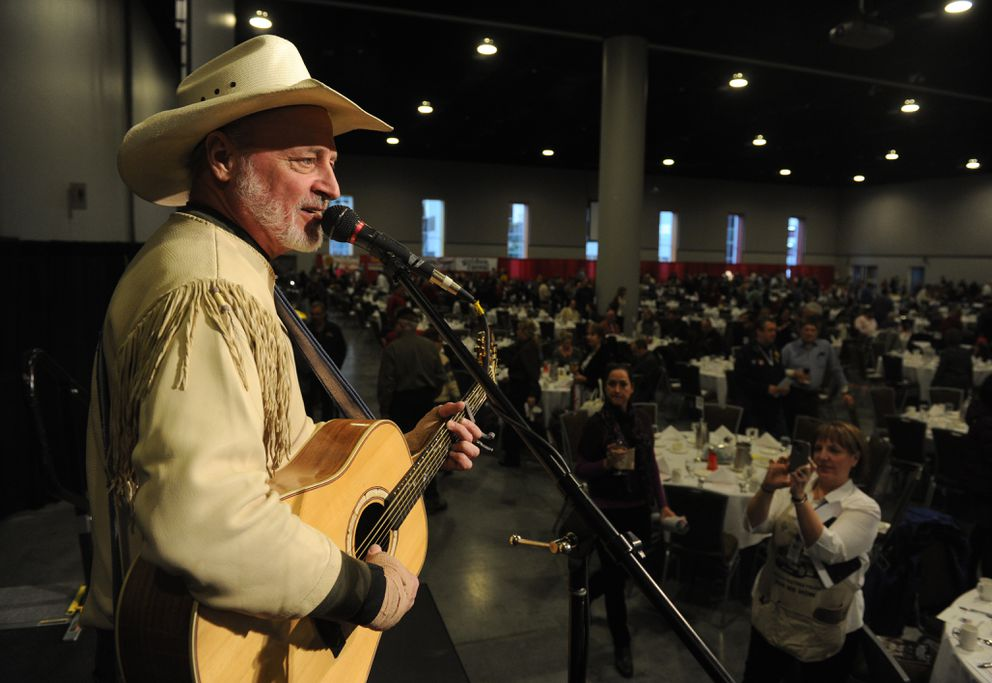 Hobo Jim sings at the 2013 Iditarod Musher's Banquet at the Dena'ina Civic and Convention Center in downtown Anchorage in February 2013. (Bob Hallinen / ADN archive)