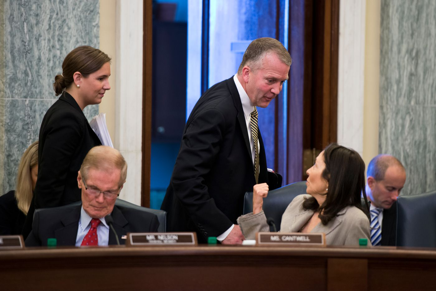 Sen. Dan Sullivan talks with Sen. Maria Cantwell (D- Washington) at a Commerce, Science and Transportation Committee meeting in the Russell Senate on Thursday, June 25, 2015. (Marc Lester / Alaska Dispatch News )