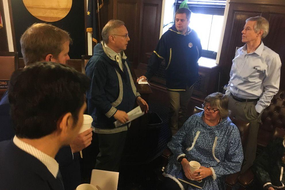 Speaker of the House Bryce Edgmon, I-Dillingham, talks to Democratic members of the new House majority on Friday. (James Brooks / ADN)