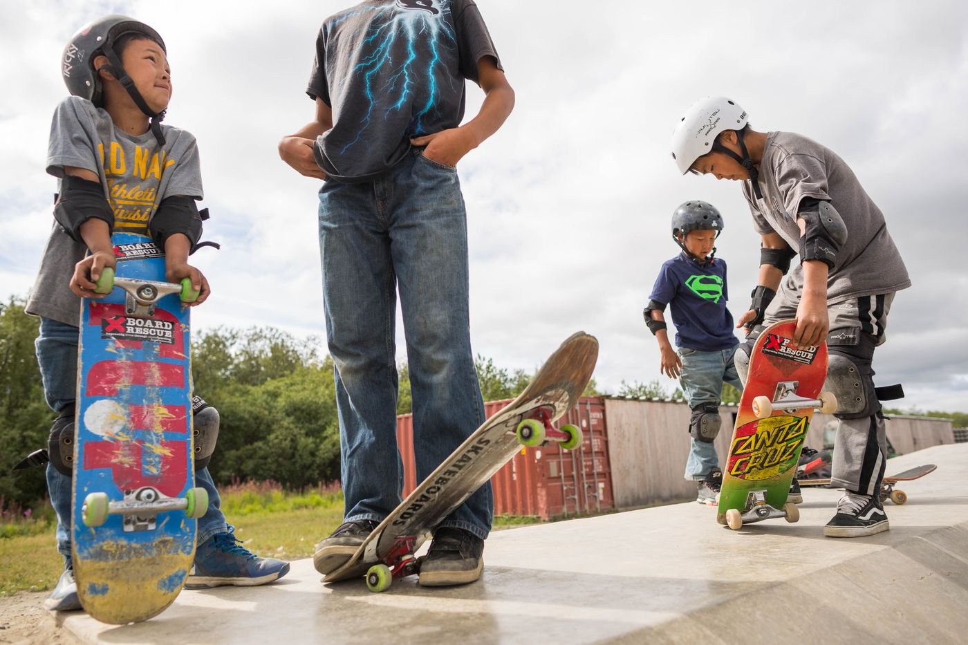 From left, Devin Jackson, 8, Ethan Nicolai, 13, Ian Fischer, 9, and Evan Waska, 13, hang out at the Kwethluk skate park on Friday, August 7, 2015. The park, which was built with an Indian Health Services grant, is the only one of its kind in a small rural Alaska village. (Loren Holmes / ADN)