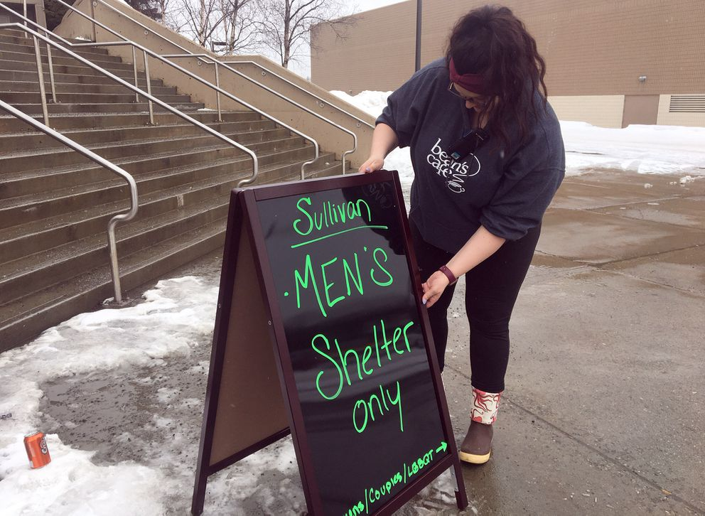 As guests at Brother Francis Shelter and Bean's Cafe moved into new quarters at the Sullivan Arena and Ben Boeke Ice Arena on Saturday afternoon, Amber Deardorff adjusted a sign indicating which facility was for men. The Sullivan will house men while Ben Boeke will house women, couples and LGBTQ individuals. (Paula Dobbyn / ADN)