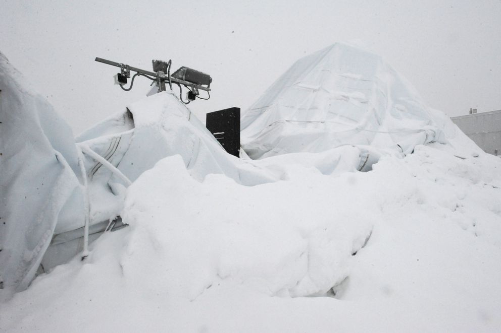 A fresh blanket of snow on the collapsed Anchorage sports dome on Monday. (Bill Roth / Alaska Dispatch News)
