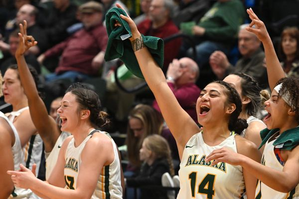 UAA players celebrate one of 16 three-point shots that broke a school record during the Seawolves' 90-36 home victory over the Nanooks at the Alaska Airlines Center on Tuesday, Feb. 11, 2020. (Bill Roth / ADN)