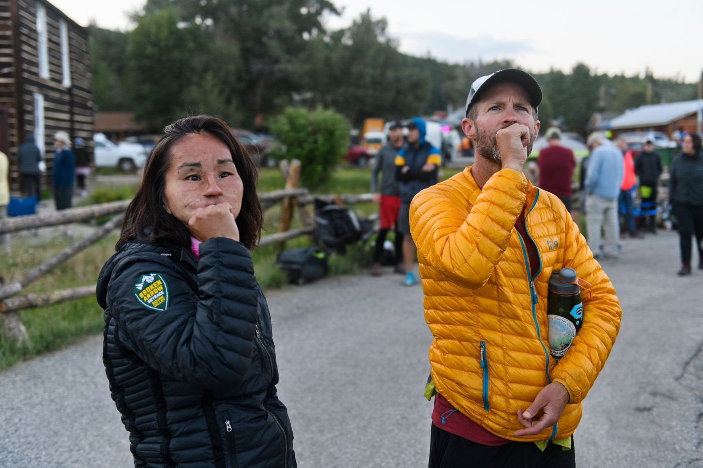 Carol Seppilu and her coach Sean Meissner look toward a mountain pass where Seppilu's Leadville Trail 100 Run came to an end on August 17, 2019. Seppilu failed to reach the mountain checkpoint before the race's cutoff time. (Marc Lester / ADN)