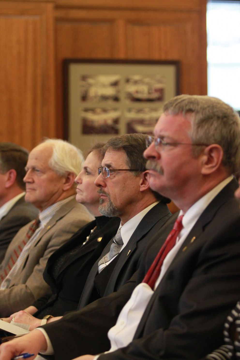 Members of the Alaska House Republican minority sit in the audience of a House Finance Committee meeting Wednesday at the Capitol in Juneau. From left, Chris Birch of Anchorage, DeLena Johnson of Palmer, George Rauscher of Sutton, and Dan Saddler of Eagle River. (Nathaniel Herz / Alaska Dispatch News)
