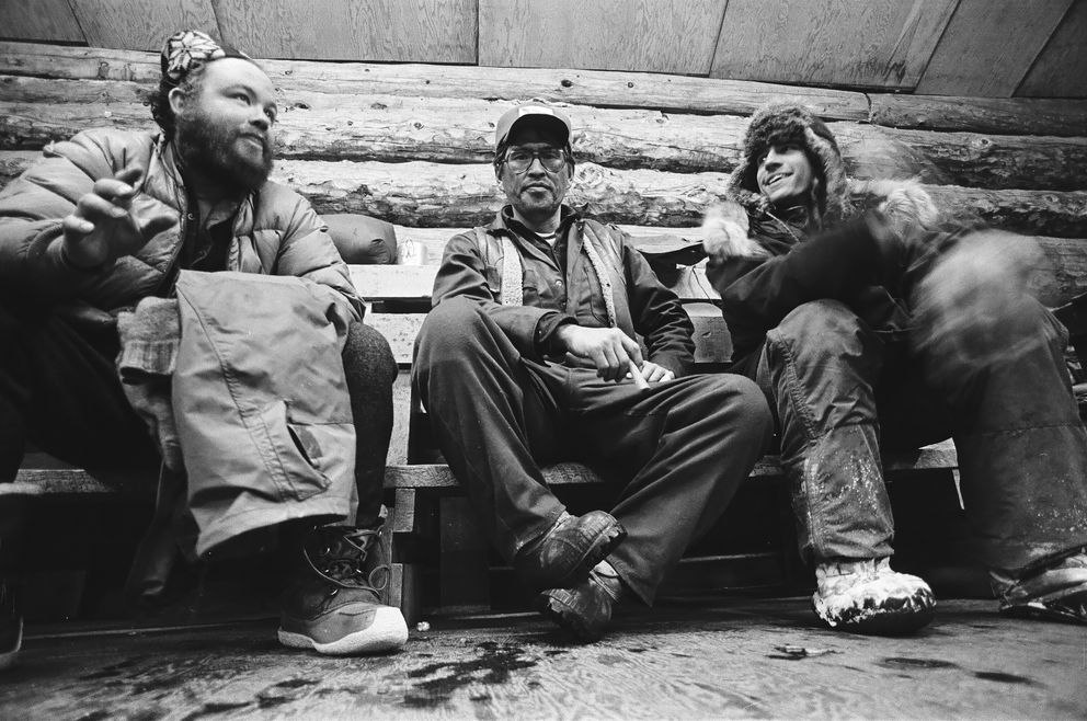 Jerry Austin, Emmitt Peters and Duane Halverson take a break in the Grayling checkpoint during the 1981 Iditarod Trail Sled Dog Race on March 14, 1981. (Marc Olson / ADN archive)