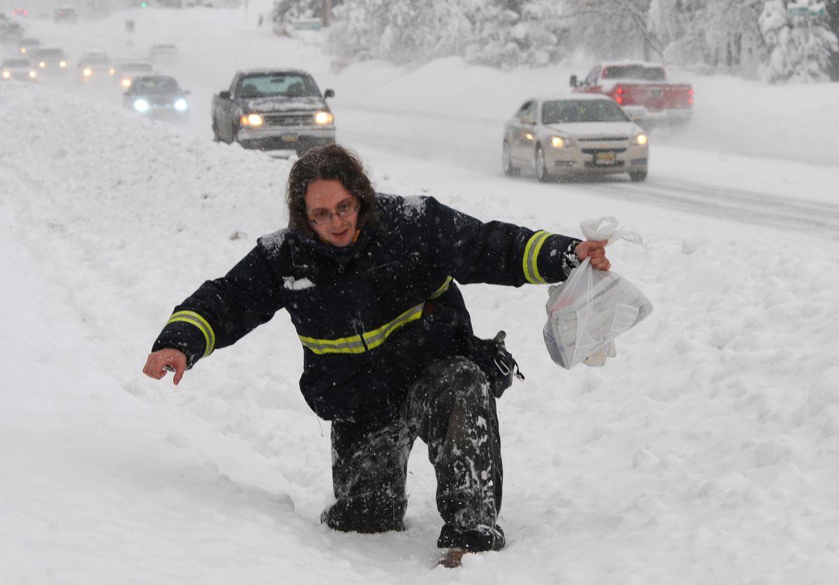 Jesse Busha walks home from work through knee-deep snow along DeBarr Road on Sunday, Jan. 22, 2017. (Bill Roth / Alaska Dispatch News)
