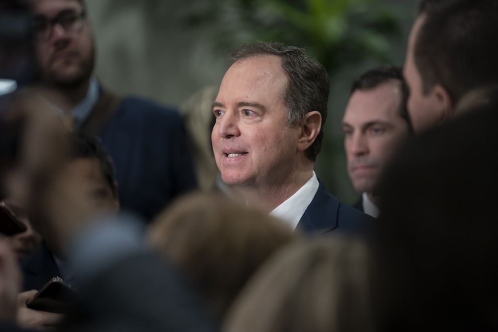 House Intelligence Committee Chairman Adam Schiff, D-Calif., is surrounded by reporters as he speaks about the impeachment trial of President Donald Trump on charges of abuse of power and obstruction of Congress, in Washington, Friday, Jan. 24, 2020. (AP Photo/J. Scott Applewhite)