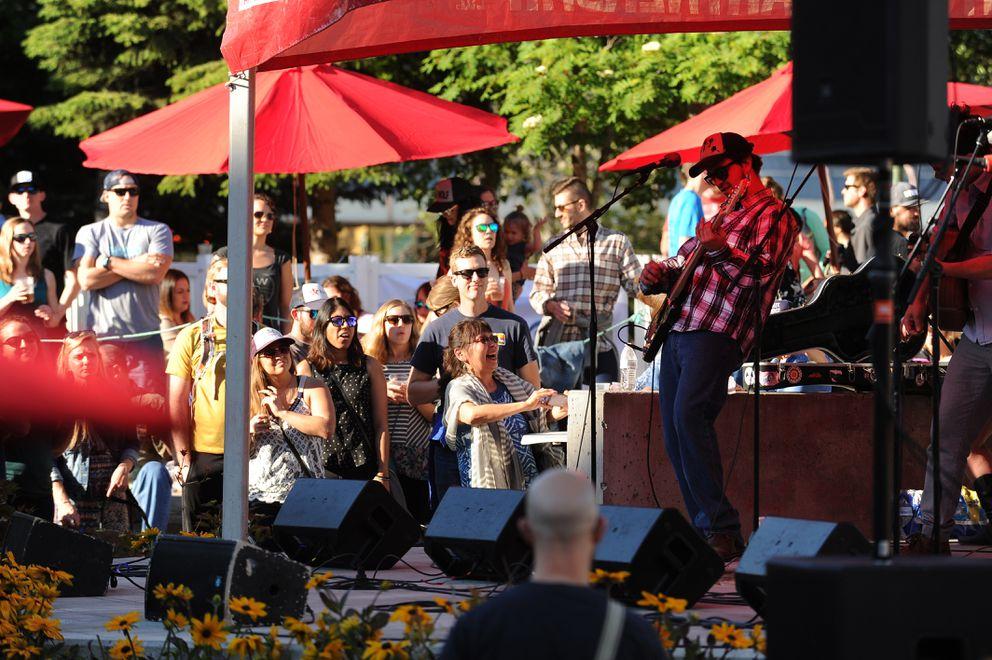 Blackwater Railroad Company performs in Town Square Park in Anchorage. (Bob Hallinen /ADN)