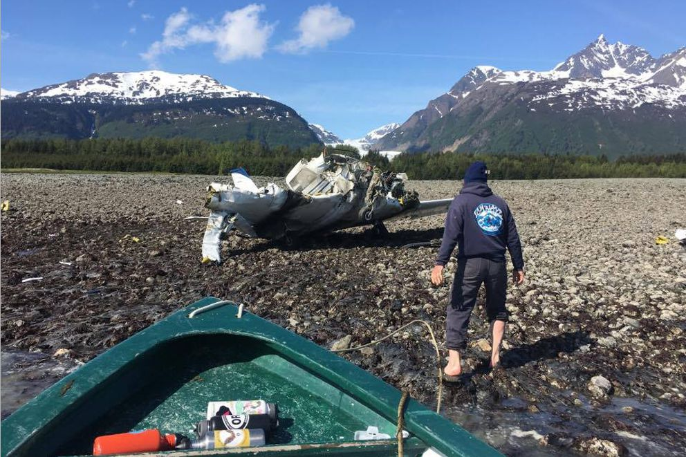 Tom Faverty approaches the scene of the wreck of a Piper Comanche that crashed on a remote moraine south of Haines on Saturday, after boating across Chilkat Inlet. (Photo courtesy of Patricia Faverty)