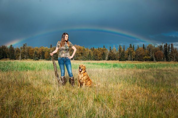 Kelli Kay had her senior portrait taken with a shotgun and her dog, Sage. (Shawna Shields / Narrow Road Productions)