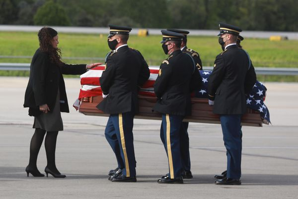 Carey Harris talks with her daughter Kaylie as casket bearers prepare to place her body in a hearse for the ride from John Glenn International Airport in Columbus, Ohio to a funeral home in Springfield, Ohio on Tuesday, May 11, 2021. Kaylie Harris was an Army MP stationed in Anchorage. She alleged that she was raped by a colleague, an Airman, in January shortly after coming out on social media. Harris's family believes the rape was also a hate crime directed at her because she was lesbian. She printed a suicide note on May 2, 2021 and was found with a gunshot wound to her head. (Doral Chenoweth / The Columbus Dispatch / USA TODAY Network) ONE TIME USE