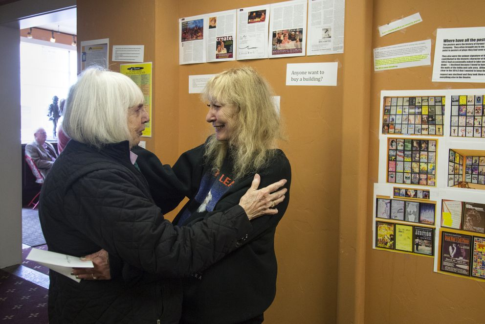 "Maggie Carey, left, and Sandy Harper embrace during the ""End of an Era"" party at Cyrano's Off Center Playhouse on Saturday in Anchorage. (Rugile Kaladyte / Alaska Dispatch News)"