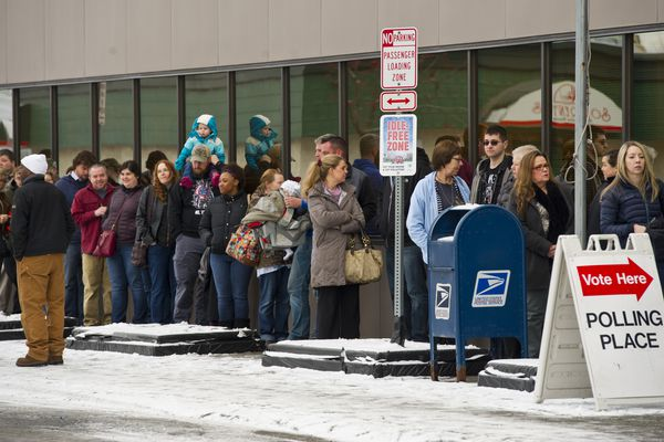Early voters waited in a line outside the Alaska Division of Elections office on Monday, November 7, 2016. Dozens of people wrapped around the building in Midtown at lunchtime Monday, November 7, 2016, to vote early.There were nurses with 12-hour shifts, a Walmart clerk with odd hours and teachers with packed schedules. All said their jobs made it tougher to cast a ballot at a precinct on Election Day. Some were also hoping to avoid crowds. Yaso Thiru, a business professor at Alaska Pacific University, drove in from South Anchorage to cast a vote. She said her job was more flexible today, but she also thought Tuesday would be busier at the polls.