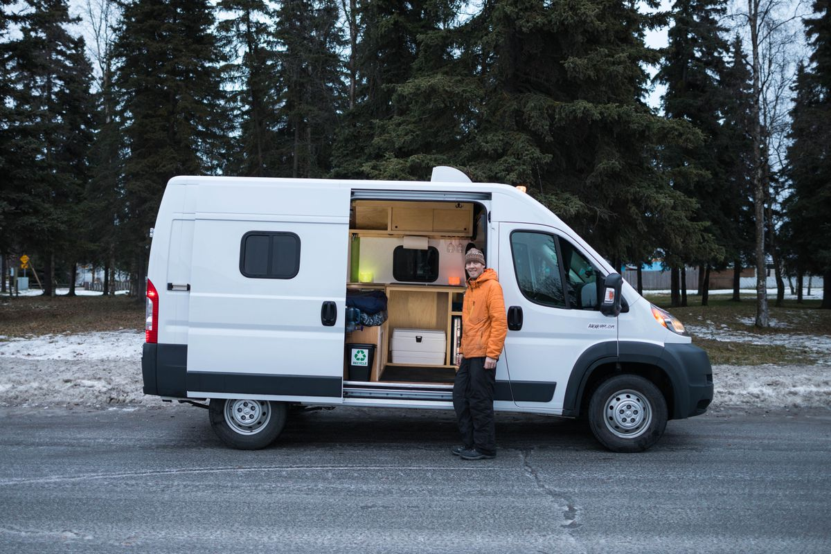 Matt Cullens, owner of AlaskaVans, with a converted Ram ProMaster that he rents to visitors seeking a more casual alternative to conventional RVs (Loren Holmes / ADN)