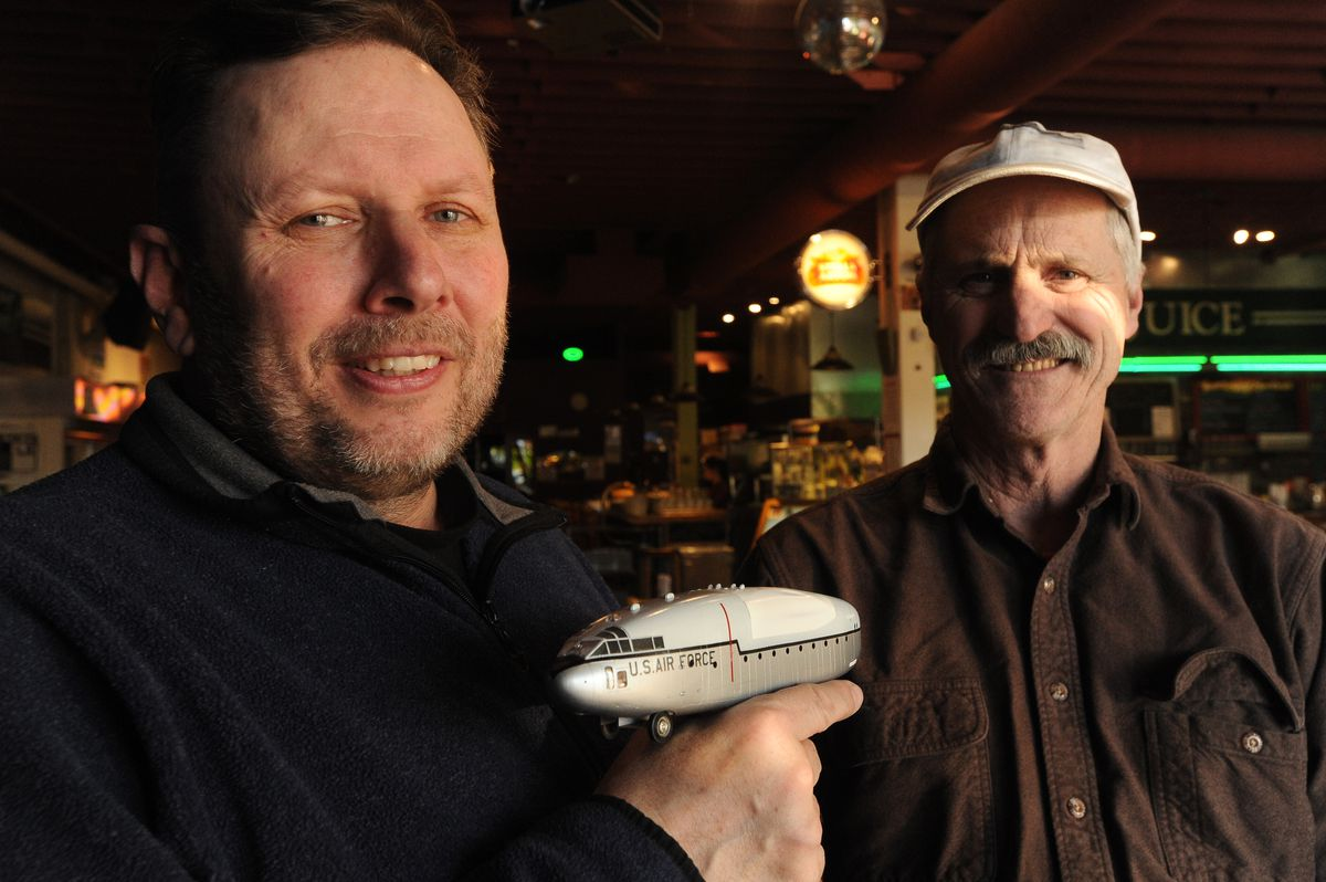 James Morris and John Will show a model of C-119 Flying Box Car they plan on turning into a road legal vehicle with a café and gallery to support veterans at Organic Oasis in Anchorage, Alaska on Thursday, Feb. 8, 2018. (Bob Hallinen / ADN)