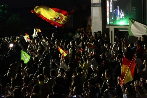 Supporters of far right party Vox cheer as the party Secretary General Javier Ortega Smith addresses them outside the party headquarters while waiting for results of the general election in Madrid, Sunday, April 28, 2019. A divided Spain voted Sunday in its third general election in four years, with all eyes on whether a far-right party will enter Parliament for the first time in decades and potentially help unseat the Socialist government. (AP Photo/Manu Fernandez)