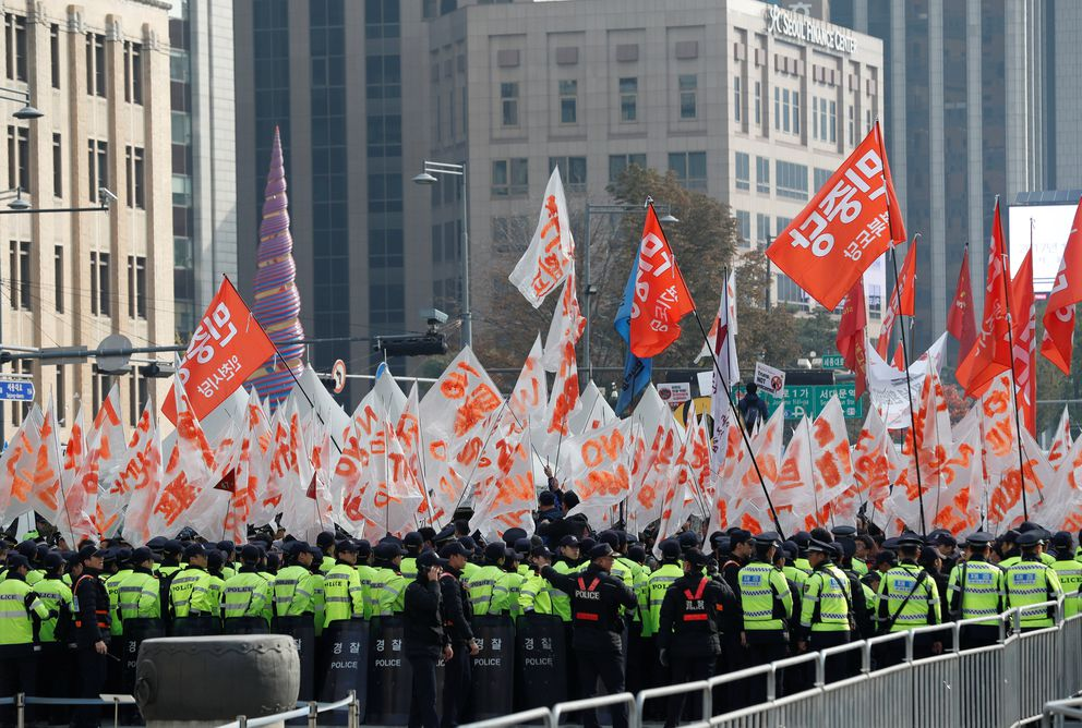 Police block protesters waiting for Trump's motorcade to pass by in central Seoul. REUTERS/Kim Kyung-Hoon