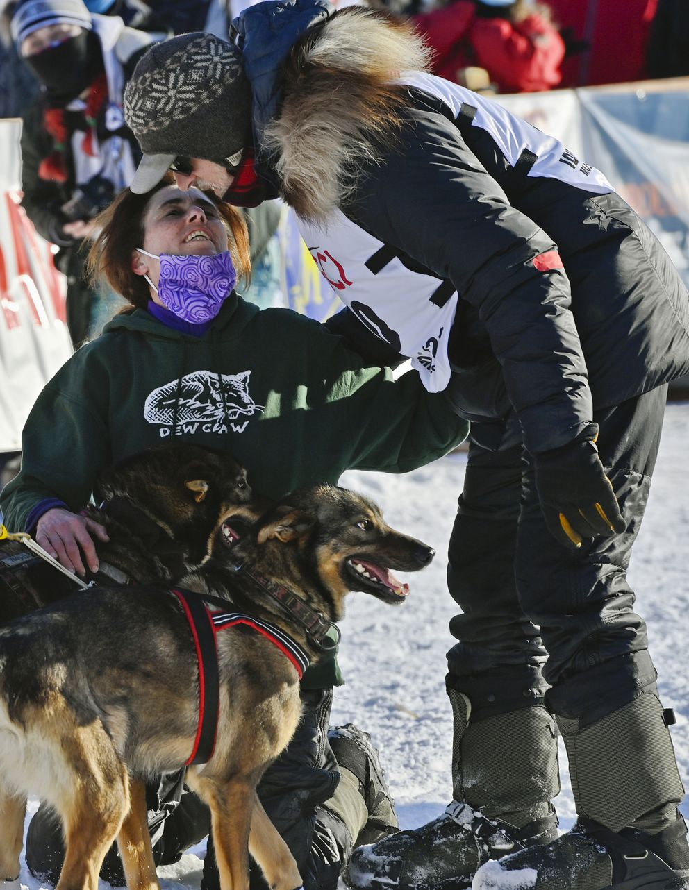 Dan Kaduce kisses his wife, Jodi Bailey, before starting the Iditarod Trail Sled Dog Race in Willow on March 7, 2021. (Marc Lester / ADN)