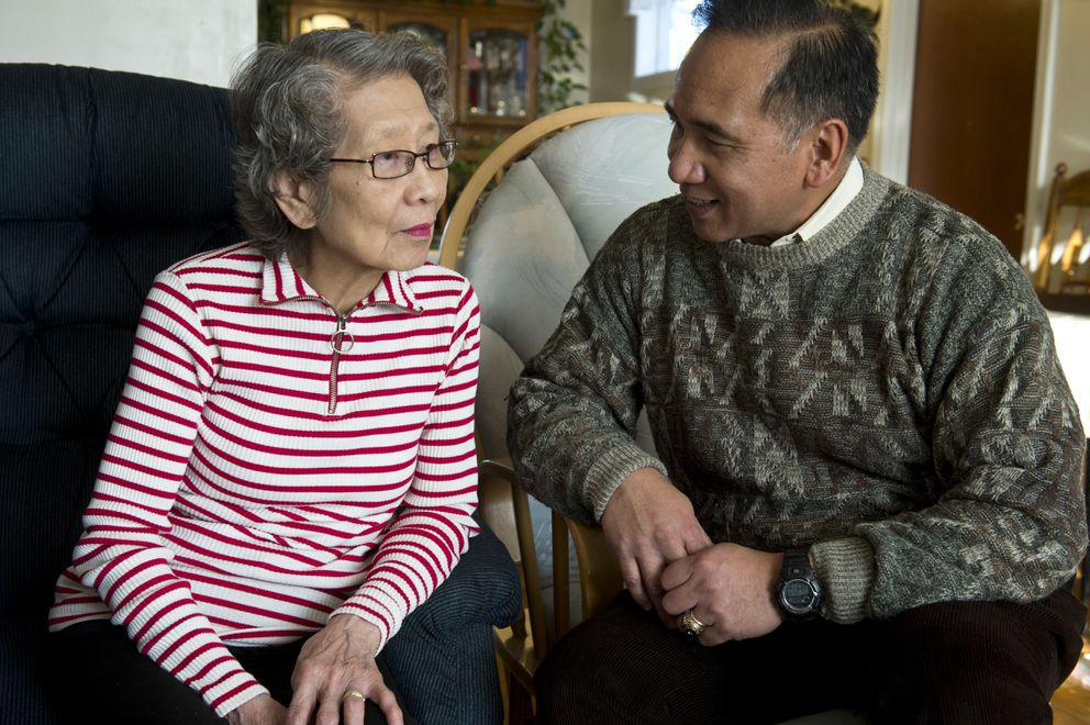Pacita Agron, left, talks with her son Gary Agron at Pacita's home in Anchorage. (Marc Lester / Alaska Dispatch News)