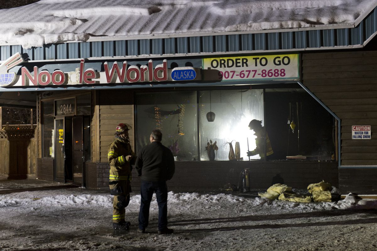 Firefighters respond to a fire at Noodle World on Tudor Road early Thursday. (Marc Lester / ADN)