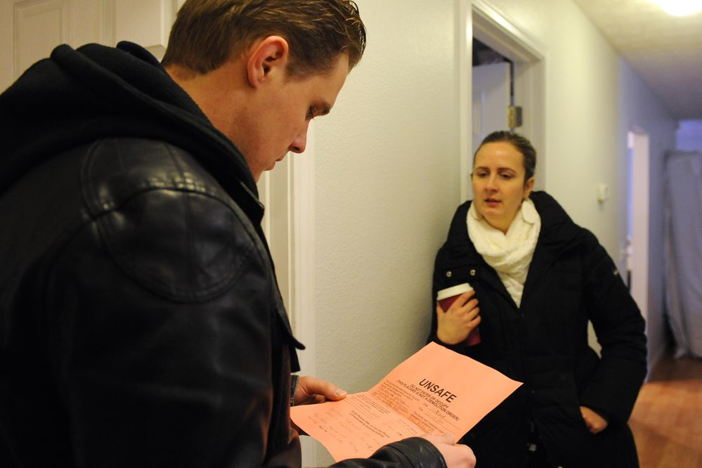 Albert Schoonbeek and Candice Roberson talk about the Unsafe tag their home received after an engineer inspected their home after the earthquake. Photographed Dec. 13, 2018. (Anne Raup / ADN)