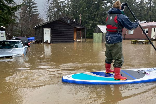 Amanda Painter paddles through a flooded area of Haines while helping a friend evacuate on Dec. 2, 2020, (Kaitlyn Tolin photo)
