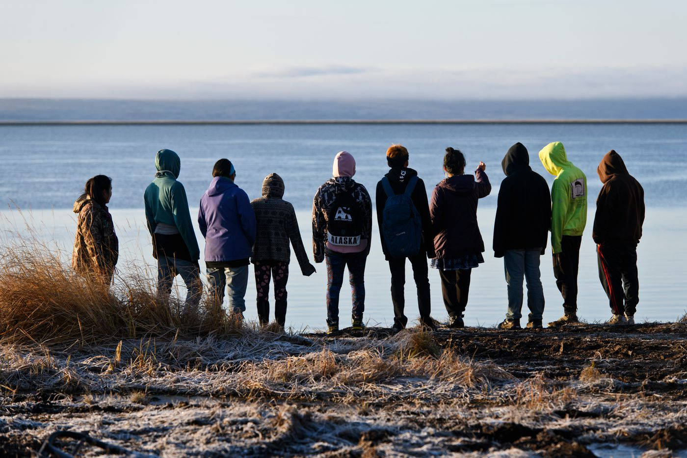 Students from Newtok's Ayaprun School walk to the edge of the Ninglick River. The eroding bank of the Ninglick River is now about 100 feet from the school at its closest point. (Marc Lester / ADN)