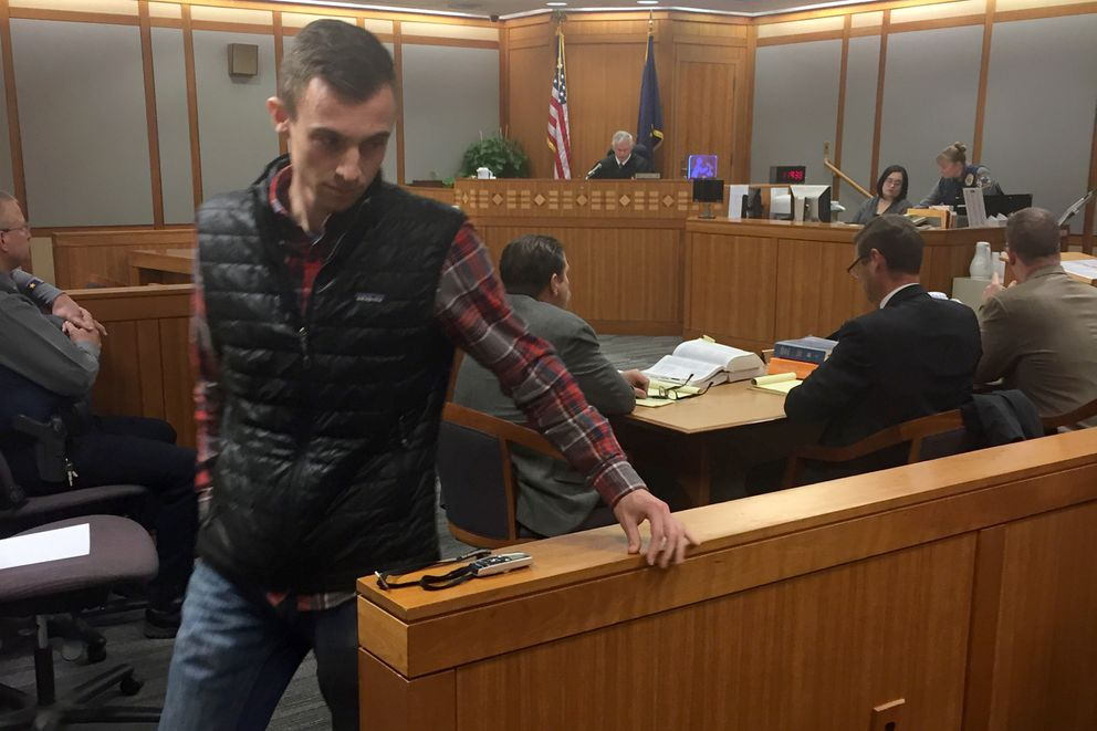 Michael DuPree returns to his seat after speaking at Anthony Pisano's bail hearing on Tuesday. (Alex DeMarban / Alaska Dispatch News)