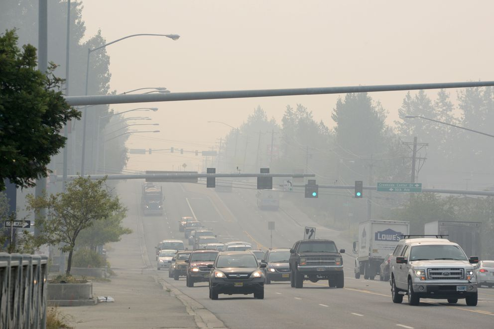 Smoke from Southcentral Alaska wildfires obscures views on Muldoon Road in Anchorage Monday, Aug. 19, 2019. (Anne Raup / ADN)