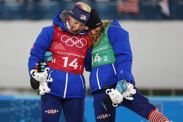 Cross-Country Skiing - Pyeongchang 2018 Winter Olympics - Women's Team Sprint Free Finals - Alpensia Cross-Country Skiing Centre - Pyeongchang, South Korea - February 21, 2018 - Kikkan Randall and Jessica Diggins of the U.S. celebrate winning gold. REUTERS/Dominic Ebenbichler