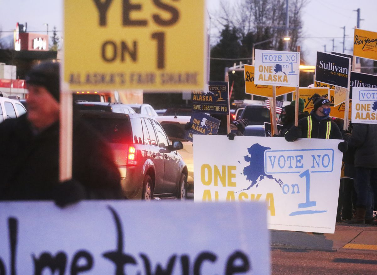 Competing signs for and against Ballot Measure 1 at the corner of East Northern Lights Boulevard and the Seward Highway, Nov. 2, 2020. (Emily Mesner / ADN)