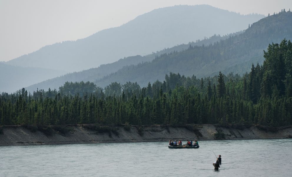 Wildfire smoke creates a hazy atmosphere on the Kenai River near Cooper Landing on July 18, 2019. The Swan Lake wildfire has been burning on the Kenai Peninsula for several weeks. (Marc Lester / ADN)