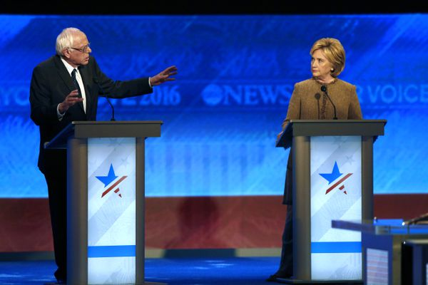 Bernie Sanders, left, offers an apology to Hillary Clinton during a Democratic presidential primary debate Saturday, Dec. 19, 2015, at Saint Anselm College in Manchester, N.H.