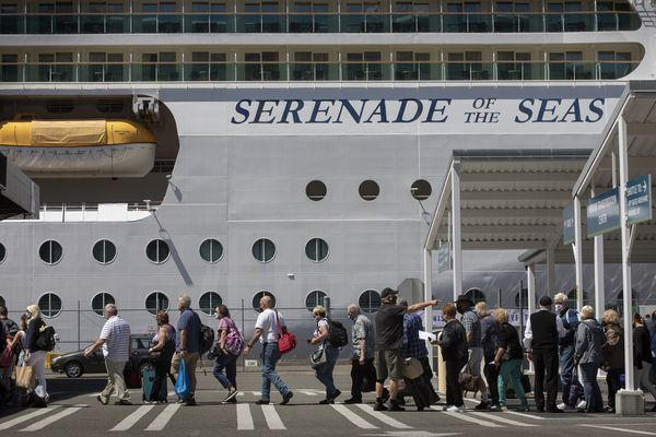 Passengers line up as they head toward the terminal where they will check in for their cruise to Alaska aboard the Serenade of the Seas at Terminal 91 in Seattle on July 19, 2021. (Ellen M. Banner/Seattle Times/TNS)