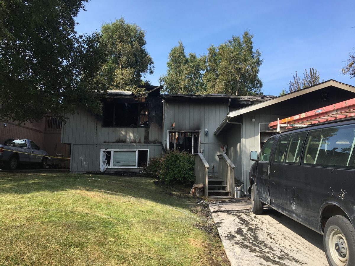 A fire at a home on the 5300 block of Tudor Top Circle, off Lake Otis Parkway, early Thursday morning, July 18, 2019, killed one person and sent two others to the hospital. (Madeline McGee / ADN)