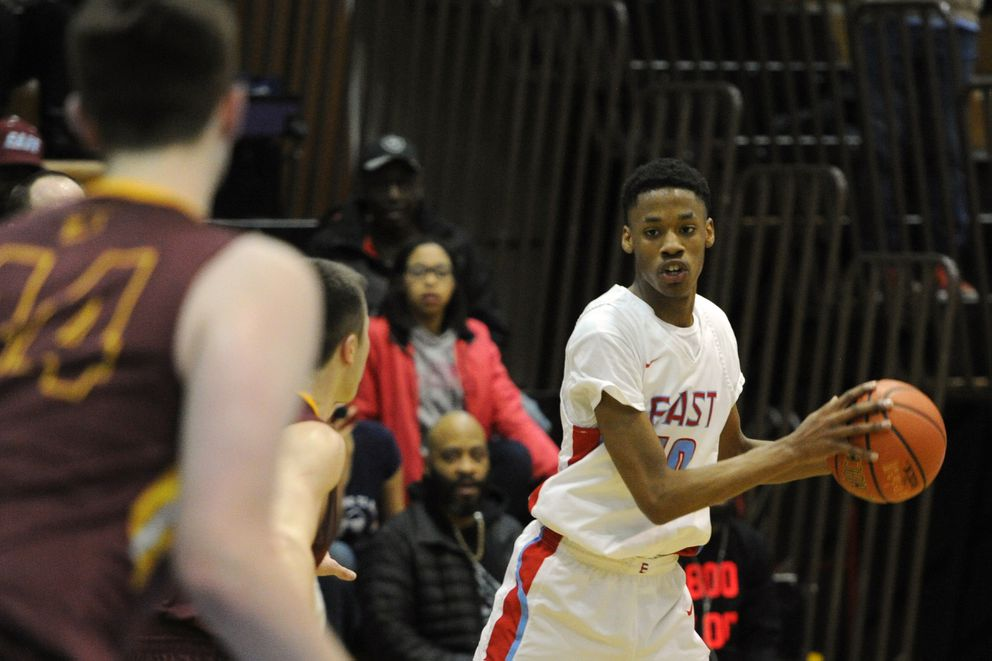 East High senior Jaron Williams looks to pass the ball during the Thunderbirds' 52-45 home loss to the Dimond Lynx on Tuesday evening, Feb 19, 2019. (Bill Roth/ ADN)