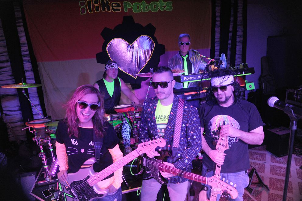 """I Like Robots band members Robb Rood and Greger Wright, in back, and Lisa Ballard, J. J. Tranquilla and Christian """"Rick James"""" Woods, in front, pose for photographs at Williwaw in downtown Anchorage, Alaska on Saturday, Jan. 13, 2018. (Bob Hallinen / ADN)"""