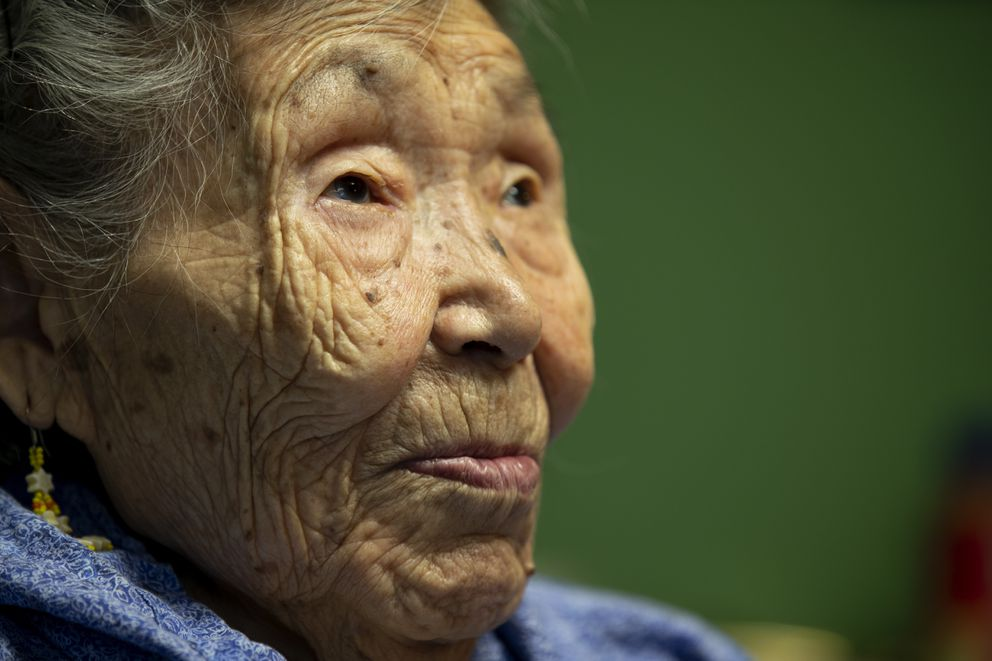 Lizzie Chimiugak looks on at her home in Toksook Bay. (AP Photo/Gregory Bull)