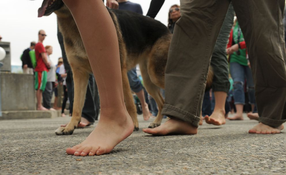 Participants in The Barefoot Mile walk in downtown Anchorage on Saturday. (Bob Hallinen / Alaska Dispatch News)