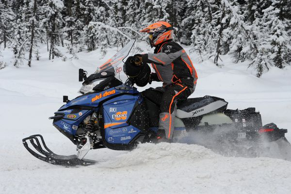 Five-time Iron Dog champion Dusty VanMeter hits the trail during the pro class restart at Big Lake on Sunday, Feb. 19, 2017. (Bill Roth / Alaska Dispatch News)
