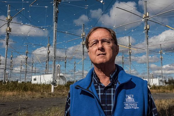 "Bob McCoy, director of the Geophysical Institute at the University of Alaska Fairbanks, stands under the Ionospheric Research Instrument at HAARP. ""It's not a weapon, and it couldn't be,"" he said. (Loren Holmes / ADN)"