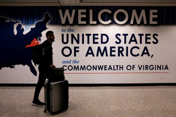 FILE PHOTO: An international passenger arrives at Washington Dulles International Airport after the U.S. Supreme Court granted parts of the Trump administration's emergency request to put its travel ban into effect later in the week pending further judicial review, in Dulles, Virginia, U.S.,on June 26, 2017. REUTERS/James Lawler Duggan/File Photo